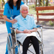 Senior Patient Talking With Kind Nurse — ストック写真