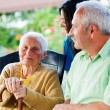 Kind Elderly Lady with Visitors — Stock Photo