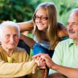 Family Visiting Sick Grandmother in Nursing Home — Stock Photo