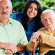 Stock Photo: Nurse with Elderly People