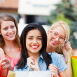 Stock Photo: Girl With Her Friends After Shopping