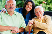 Nurse with Elderly People — Stock Photo