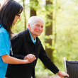 Doctor Helping Elderly — Stock Photo