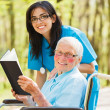 Nurse and Patient Reading — Stock Photo #30352175