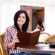 Happy woman at restaurant — Stock Photo