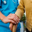 Caring Doctor and Senior Lady Hands — Stock Photo