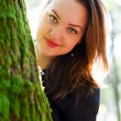 Beautiful Woman behind a Tree — Stock Photo