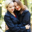 Stock Photo: Embracing Loving Sisters