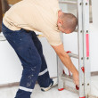 Handyman Mounting Step Ladder — Stock Photo