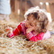 Little Girl in Hay — Stock Photo