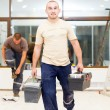 Stock Photo: Electricians after Work with Tool Boxes