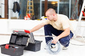 Service Man with His Toolbox — Stockfoto