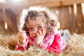 Fuzzy Haired Child in Hay — Stock Photo