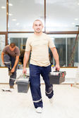 Electricians after Work with Tool Boxes — Stock Photo