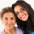 Stock Photo: Doctor caring about elderly grandmother