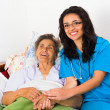 Stock Photo: Caring nurse with patient
