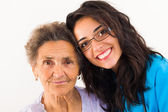 Doctor caring about elderly grandmother — Stock Photo