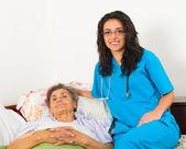 Nurse caring about elder patient — Stock Photo