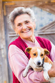 Laughing woman with puppy — Stok fotoğraf