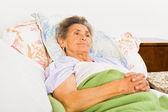 Elderly woman daily prayers — Stock Photo