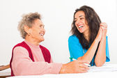 Laughing elderly lady and nurse — Stock Photo