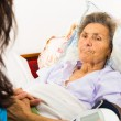Stock Photo: Nurse caring for senior patient