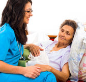 Kind nurse with elderly lady — Stock Photo