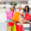 Girlfriends with lots of shopping bags — Stock Photo #35527517