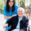 Doctor with elderly woman — Stock Photo