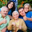 Doctor and family thumbs up — Stock Photo #35527515
