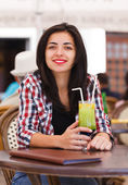 Girl drinking juice — Stock Photo