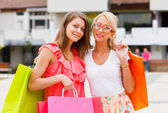 Girlfriends out for shopping — Stock Photo