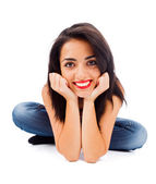 Brunette woman sitting and smiling — Stock Photo