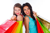 Women together holding shopping bags — Stock Photo
