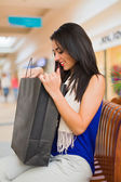 Lady having a glance in the bag — Stock Photo