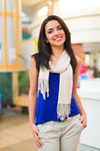 Pretty young lady in a mall — Stock Photo
