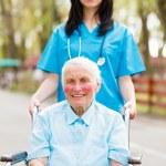 Walking with Senior Lady — Stock Photo #40987823
