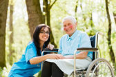 Smiling Doctor with Kind Woman — Stock Photo
