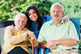 Doctor and Seniors — Stock Photo