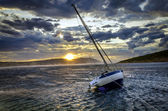 Moored sailboat in heavy winds — Stock Photo