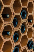 Wine rack with bottles — Stock Photo