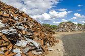 Scrapheap metall högar — Stockfoto