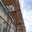 Foto Stock: Scaffold on old house