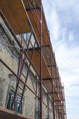 Scaffold on old house — Stock Photo