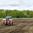 Planting seeds with tractor — Stock Photo