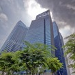 Modern office buildings against clouds — Stock Photo