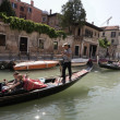 Tourists on a gondola along the canals of Venice — Stock Photo