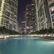 Swimming pool among high rise buildings — Stock Photo #14308711