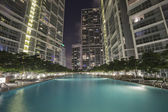 Swimming pool among high rise buildings — Stock Photo
