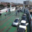 Ferry embarking passengers and vehicles — Stock Video #14344351